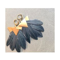 Katerina Psoma's feather earrings  www.idconceptstores.com