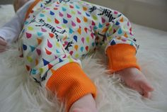 Who says rain has to be grey and dull? Enjoy bringing bright colours to your day with these fantastic baby / children's harems. Ideal for your baby, toddler or child to stand out from the crowd. Perfect for teaming with any Mini Medley top, for when you want a bold look. Let your kids true colours shine with these handmade vibrant harem trousers. These trousers are designed to be roomier in the seat, making them perfect for cloth nappies and disposables alike. The overlocked seams ma...