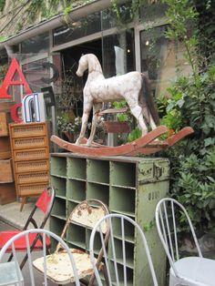 Paris Flea Market  love that shelf that the horse is on.
