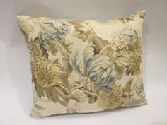 White Dual sided toss pillow with floral and stripes patterns of blue, green and ivory