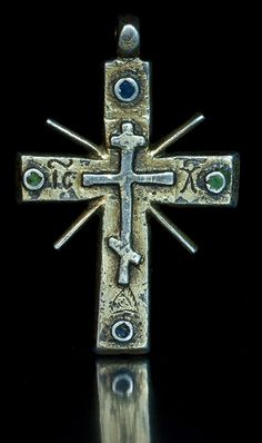 This large gilded silver and enamel eight pointed cross pendant is from the reign of Czar Ivan IV the Terrible (1530-1584). In the 16th century, Russia didn't have its own sources of silver and gold, precious metals were imported from Europe and were scarce and expensive.  The cross is covered with a thick layer of gold and embellished with green and blue enamel in Byzantine tradition.