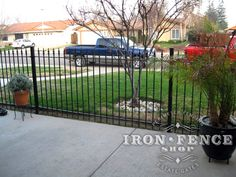 Outward view of a 4ft tall wrought iron fence and gate being used to enclose a small front patio