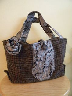 beautiful wool suit jacket made into classy handbag that you will feel pretty sharp wearing around. It has vintage tie on front and two 18 tie