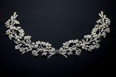 Cartier - Devant de corsage Azucenas. En platino y diamantes, propiedad de Mary Scott Townsend y la señora de Donald McElroy.