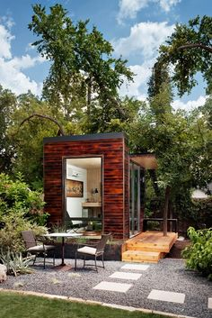 A modular studio (for use as a home office, guest room, or play space) made from shou sugi ban siding by Sett Studio of Austin, Texas. In ad...