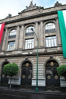 """Facade of Secretariat of Public Education Main Headquarters which faces San Ildefonso Street corner of Republica Argentina Street, in the historic center of Mexico City, MEXICO.  The building has two courtyards which Diego Rivera named """"Labor Courtyard"""" and """"Fiesta Courtyard"""".  They are decorated with Diego Rivera murals."""