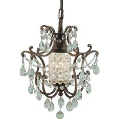 This duomount pendant/semi-flush fixture hopes to capture the spirit of the French Versailles age of opulence. From the central faceted crystal spire to the slender and graceful curved arms adorned with multiple layers of hand-polished faceted crystals, this collection is rich with romantic detailing. Comes in a British Bronze finish.   Can be installed as a fixture or semi flush mount.