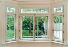 The bay window was constructed to match the doors including the inswing sash and leaded glass transom.