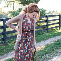 This look brings a summer dress straight into fall! It's a great way to style colored tights and boots too. Fall styling made easy!