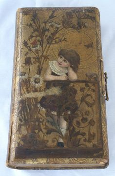 Victorian album with gilded leather, embossed child on cover