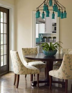 dining rooms - Sara Chandelier turquoise dining room cream chandelier blue glass bottles chandelier yellow blue upholstered chairs  Via House