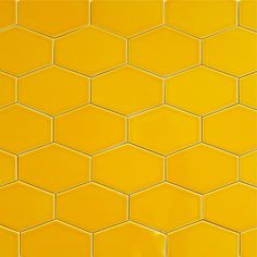 "Stretch Hex Tile - Goldfish - Our ceramic stretched hex tile in color ""Goldfish"" is a bright orange. There are 11 tiles per square foot of material and they are shipped loose for easy installation. This tile is well suited as kitchen backsplash tile, bathroom tile or as any indoor wall tile. All Clayhaus for modwalls subway tiles are handcrafted in the USA. Our artisans take care to ensure the highest quality of workmanship goes into every step, from clay extrusion, to hand cutting, to ..."