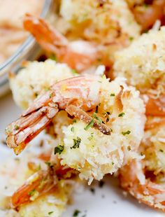 This shrimp appetizer delivers the crunch! Crusted with panko bread crumbs and shredded coconut, then baked for a healthier finish. Serve with your favorite creamy dipping sauce. Healthy Coconut Shrimp, Coconut Shrimp Recipes, Prawn Recipes, Ww Recipes, Fish Recipes, Seafood Recipes, Cooking Recipes, Seafood Meals, Online Recipes