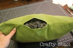sew outdoor pillows using shower curtain/vinyl tablecloth for fabric & plastic bags for stuffing