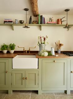 Real home: a Cotswold stone house is restored to its former glory - green kitchen with wooden worktops and butler's sink with brass taps - Sage Green Kitchen, Green Kitchen Cabinets, Painting Kitchen Cabinets, Kitchen Backsplash, Cottage Kitchen Counters, Wooden Worktop Kitchen, Kitchen Cupboard Colours, Beech Kitchen, Olive Kitchen