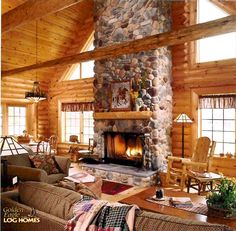 Log Home By Golden Eagle Log Homes - golden eagle log logs cabin home homes house houses rustic knotty pine custom design designs designer floor plan plans kit kits building luxury built builder complete package packages beautiful great room with tall huge stone fireplace in a small log cabin kit