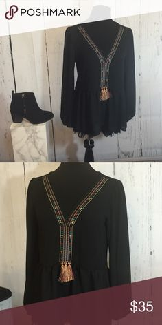 Black Tassel Top Adorable black, long sleeved top with a pattern  following the v-neck and ending mid abdomen with three tassels. Tops