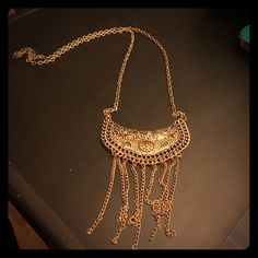 Gold colored fashion necklace Gold colored necklace. It measures approximately 15 1/2 inches long. Jewelry Necklaces