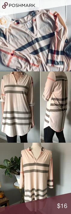 """Soft Plaid Tunic with Cropped Sleeves Soft & flowy tunic.  Cropped sleeves that can be rolled & buttoned.  Soft pink with maroon, peach, cream, & gray stripes.  V-neck.  I'm not familiar with the brand and couldn't find out much about it online.  The size tag is listed as an XL but in my opinion it's more of a sm/med.  Please see measurements to gauge fit.  Approx measurements Pit to pit: 20.5"""" Shoulder to hem: 32""""  👗 Dress form is a size 4/6 🏠 Pet & smoke-free home  🚫 No trades  💕 I…"""