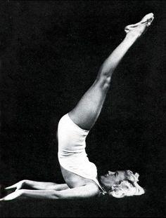 Marilyn Monroe practices Shoulderstand.