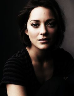Marion Cotillard; simple dress, simple hair and no make-up (or looks like none) -- I like this look