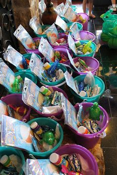 One of most kids favorite things about a birthday party is the goody-bags or party favors. I decided to use aqua & purple sand-pales that I found for only $1 each at Michaels as the good bags! I filled them with fun water toys like: beach balls, wind up fish, squirt guns, bubbles, etc.
