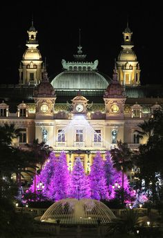 Christmas lights illuminate Monte-Carlo's casino in Monaco.  Been there, not at Christmastime but, I bet it's even more beautiful then.