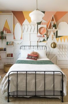 It's A Small World Bedroom Makeover Reveal! - Vintage Revivals All the details on the Process of creating the It's A Small World Geometric Wall and decorating the bedroom.  #accentwall #diy #bedroomreno