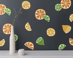 Dramatically convert the look of your living space with these adorable 4-color assorted citrus wall decals, giving your walls the look of a custom paint job without any of the hassle! This set features three different styles of citrus designs for oranges, lemons, and limes. The decals were created from my original design and arent available from any other seller :)   ***ITEM DETAILS***  • Each decal ranges between approximately 2.5 - 5 in diameter  • There are 3 different styles citrus…