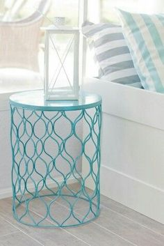 Spray paint metal trash can. once dry, flip over and use as night stand.