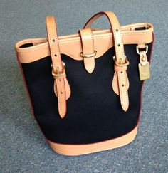 Dooney and Bourke handbag | Black and Tan -- Looks brand new! | Fashion II Consignment Boutique - Lincoln, NE