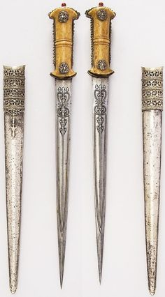 Ottoman hancer / court dagger, 18th to 19th century, steel, ivory, silver, wood, possibly coral, L. of blade 14 1/2 in. (36.8 cm) L. with sheath 20 11/16 in. (52.5 cm); L. without sheath 19 1/2 in. (49.5 cm); W. 2 3/16 in. (5.6 cm); Wt. 14.1 oz. (399.7 g); Wt. of sheath 6.9 oz. (195.6 g), Met Museum, Bequest of George C. Stone, 1935.