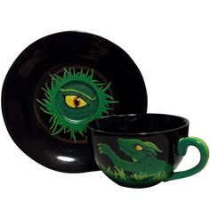 This rising green dragon is as at home within the green leaves as you will be drinking from this cup. Green Dragon, Green Leaves, Drinking, Tea Cups, Artisan, Artwork, Drinks, Craftsman, Drink