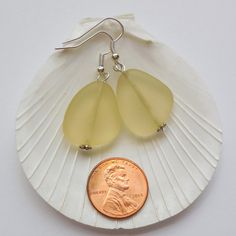 Large Lemon Yellow Sea Glass Earrings,Sea Glass Jewelry,Seaglass Earrings,Seaglass Jewelry,Beach Glass Jewelry,Beach Glass Earrings,Beach Jewelry. Handmade dangle earrings with a 21-23 mm translucent Lemon Yellow recycled glass flat bead. These simple earrings are a pretty light yellow color that would be perfect for a beach wedding. They are available in earwire, earpost or clip on. Specify your choice of style: Earwire, Earpost or Clip on. Upgrade all non-decorative silver to Sterling Silver f Dangly Earrings, Simple Earrings, Glass Earrings, Star Earrings, Drop Earrings, Sea Glass Jewelry, Beach Jewelry, Unique Jewelry, Yellow Sea