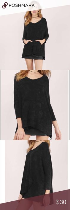 """*Cozy Black V-neck Tunic Top Brand new in packaging Tobi wicked games V neck top. Loose fitted top with a v- neckline and a front pocket. Made of cotton/rayon/spandex. Provides great stretch and is so comfortable. Material is pretty thick so very warm. Color is black. Measurements: bust 36"""" length 27"""". Size medium. Tobi Tops Tunics"""