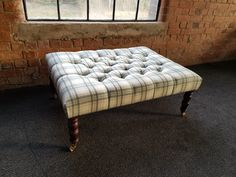 Deep buttoned footstool in Abraham Moon wool