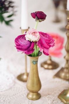 We have a bunch of assorted vintage brass vases we will bring to place around the desserts or wherever desired. We also have vintage brass stands for taper candles if we want them!