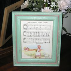 I love this! Have several of the most popular nursery rhymes framed on food tables... Nursery rhyme baby shower decor