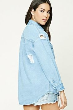 A denim shirt featuring a distressed design, button front, basic collar, two front flap button pockets, a curved hem, and long button cuff sleeves.