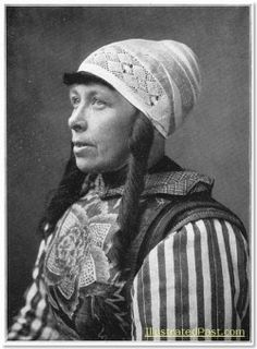 """A woman  from Marken Island, North Holland, wearing traditional costume. The elaborate breast plate is called """"construction"""" c. 1916"""