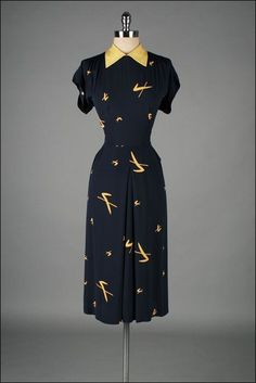 Fabulous 1940s navy blue and yellow short sleeve novelty print dress. #vintage #1940s #fashion