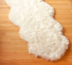UltraPlush Faux Sheepskin Rug - Premium Quality Faux Fur Area Rug 2ft x 6ft - White ULTRAPlush Series * New and awesome product awaits you, Read it now  (This is an amazon affiliate link. I may earn commission from it)