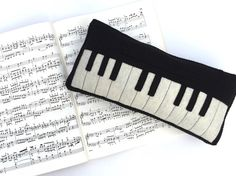 This adorable piano is a perfect addition to any music lovers collection. Great for pretend play with your little ones, as a pillow in your music