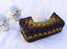 Need a handmade gift for someone who wouldn't appreciate pink and frilly, or kitschy and colorful? Here it is! Who would have thought that a crocheted granny tissue box cover would be a good gift for a man....well me, actually,...