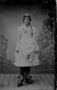 ca. 1890's, [portrait of a young lady on roller skates]
