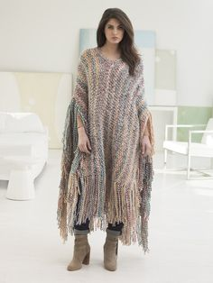 Make a statement with this bold fringed poncho! Make it with Lion Brand Wool-Ease Thick & Quick - free knit pattern calls for 10 balls of yarn (pictured in hudson bay) and size 13 36-inch circular knitting needles.