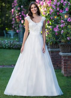 Inspired by a fairy tale, this A-line gown features a scoop neckline, beaded applique lace bodice, natural waistline accented by a Satin cummerbund, and an organza skirt with chapel length train. https://www.sinceritybridal.com/wedding_dress/3912