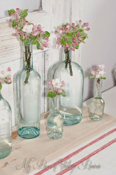 Save all your interesting bottles for an always interesting display of flowers and ferns.