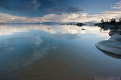 """""""Lake Tahoe 15"""" - This photograph of clouds reflecting on the surface of Lake Tahoe and the sandy bottom were photographed in the evening at Speedboat Beach."""