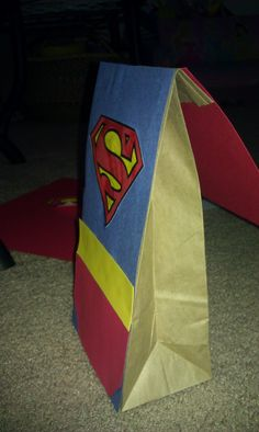 Superman Party Favor Bag People can put extra food in there for midnight premiere!!! Maybe have some dollar store candy in there too...